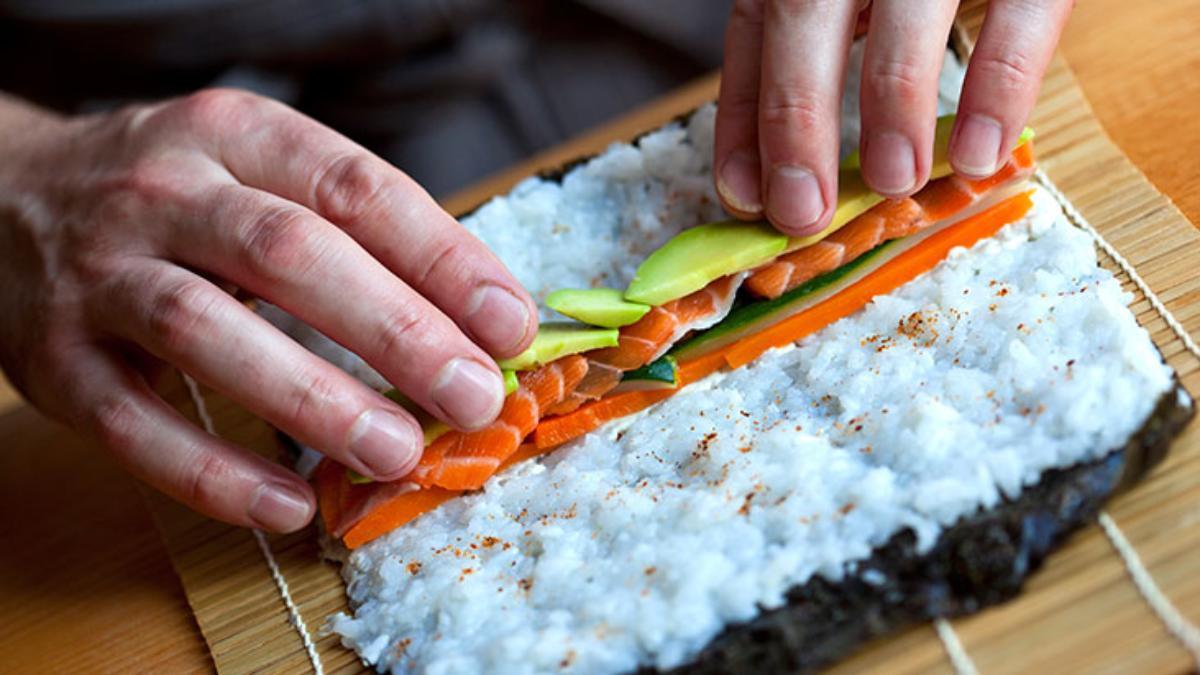 sushi chef rolling maki