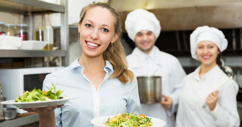 happy waitress cooks
