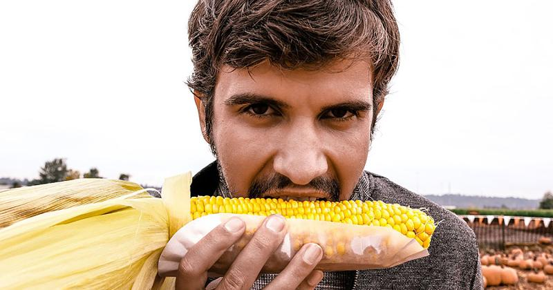 man eating corn
