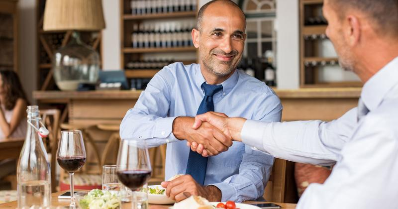 businessmen handshake lunch