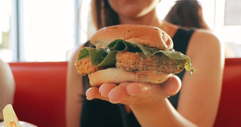 earth burger sandwich hand