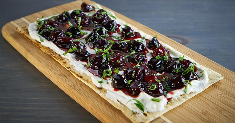 Baharat Spiced Cherries and Labneh on Flatbread