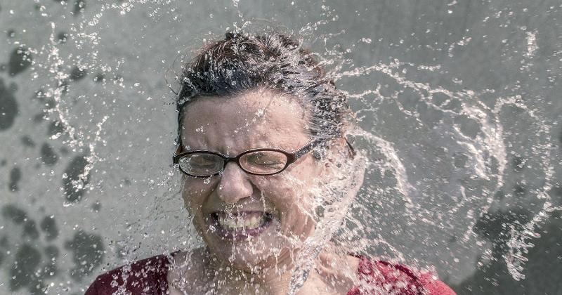 woman water face