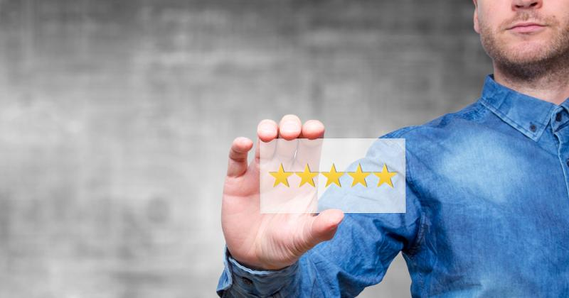 man holding 5-star rating