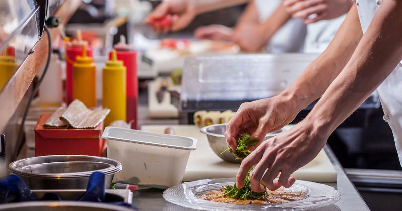 chefs preparing plates