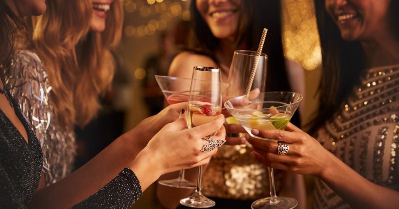 women drinking cocktails