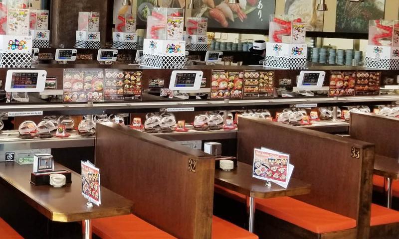 kura revolving sushi bar interiors