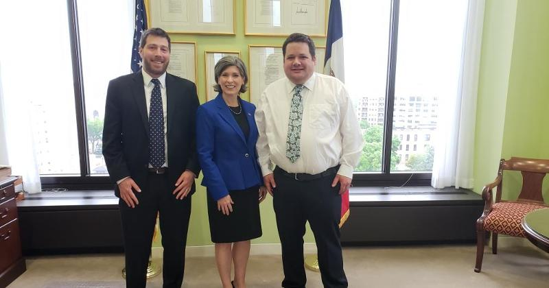 Photo: Sen. Joni Ernst (R-Iowa) meets with Mike Green, manager of FMI state government relations (left), and Nick Graham, owner of Heartland Markets (right).
