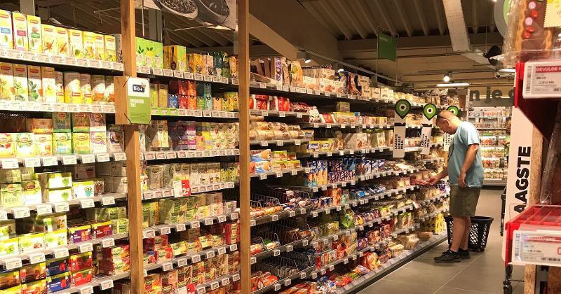 Plus Center Store Aisles Call Out Organic and Lowest Prices