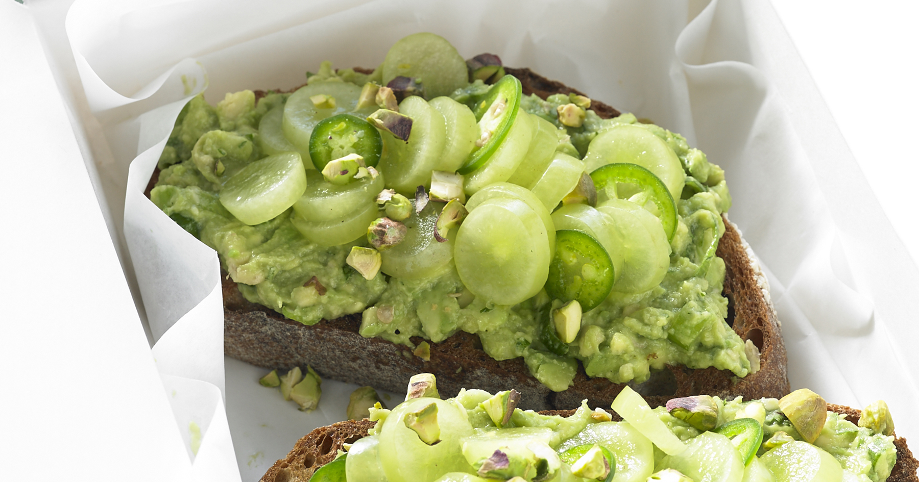 Smashed Avocado Toast With Grapes, Pistachios and Jalapeno