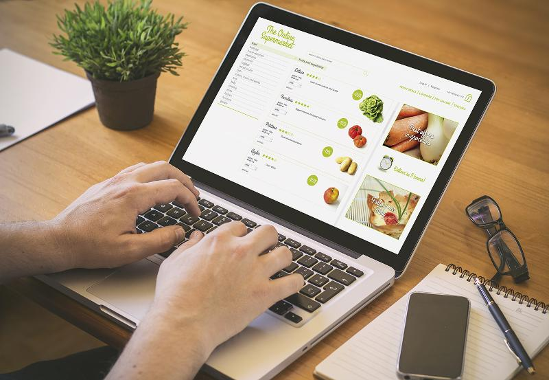 Consumer using laptop to grocery shop