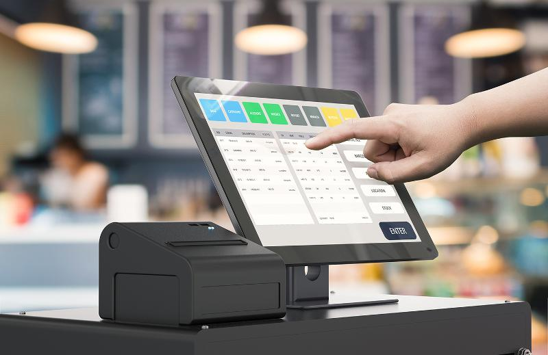 Employee working POS system