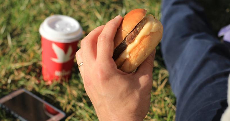 person holding breakfast sandwich