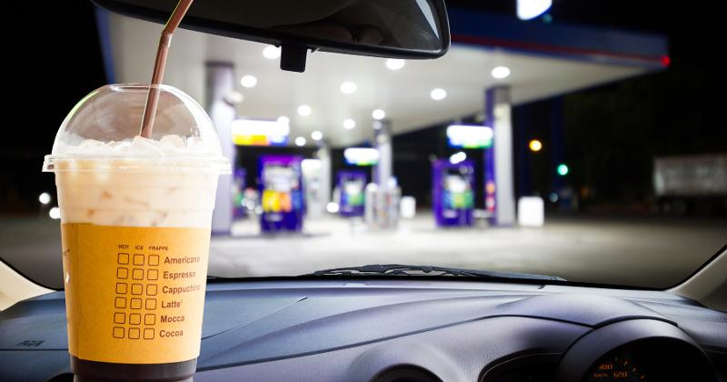 coffee in a car at a gas station