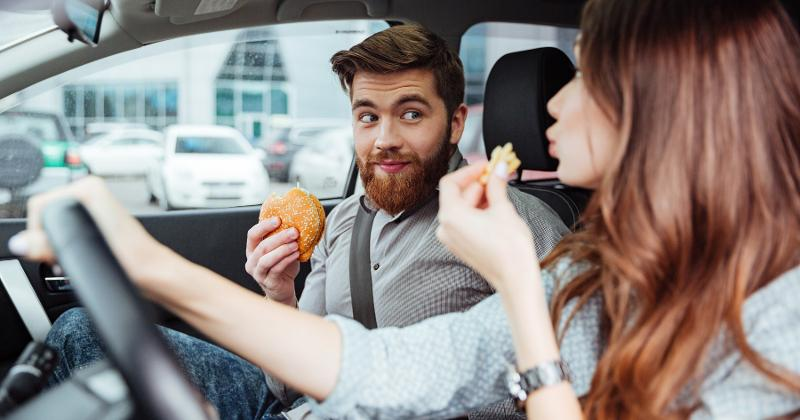 couple eating in a car