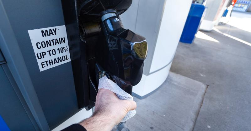 wiping down gas pump
