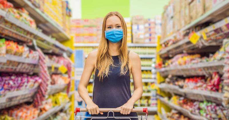 masked woman shopping