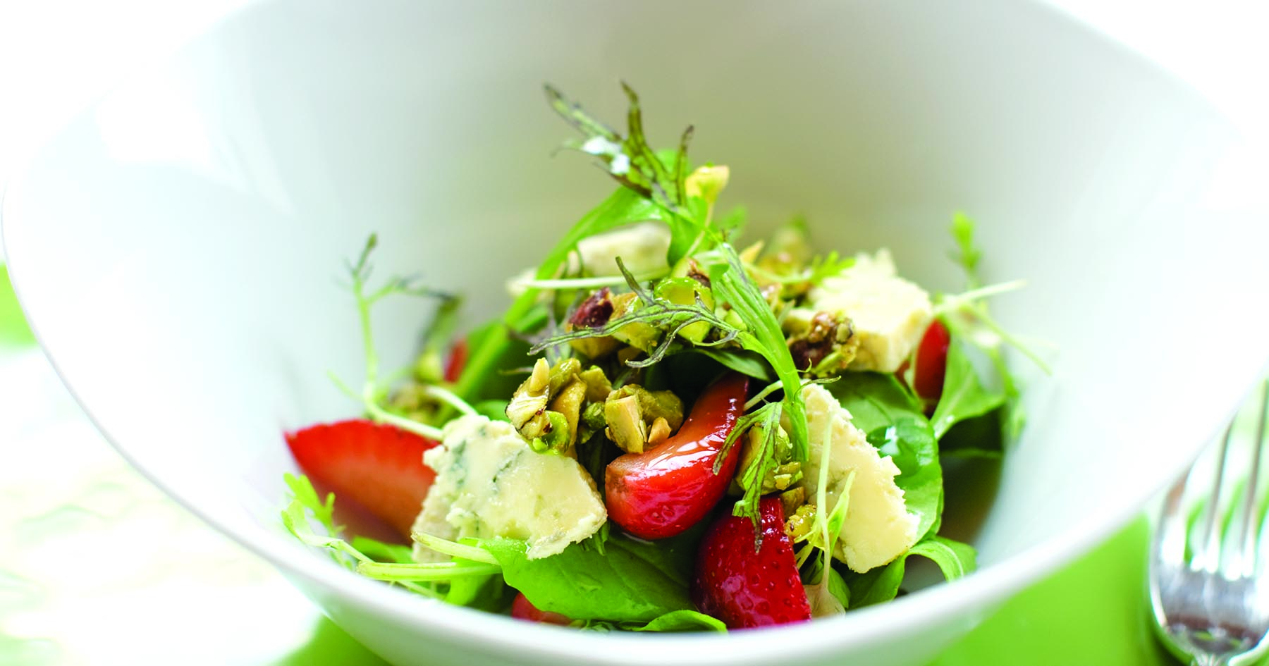 Arugula Salad With Pickled Strawberries, Candied Pistachios and Crumbled Blue Cheese