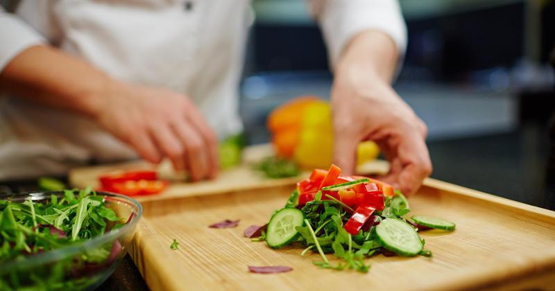 chef slicing veggies