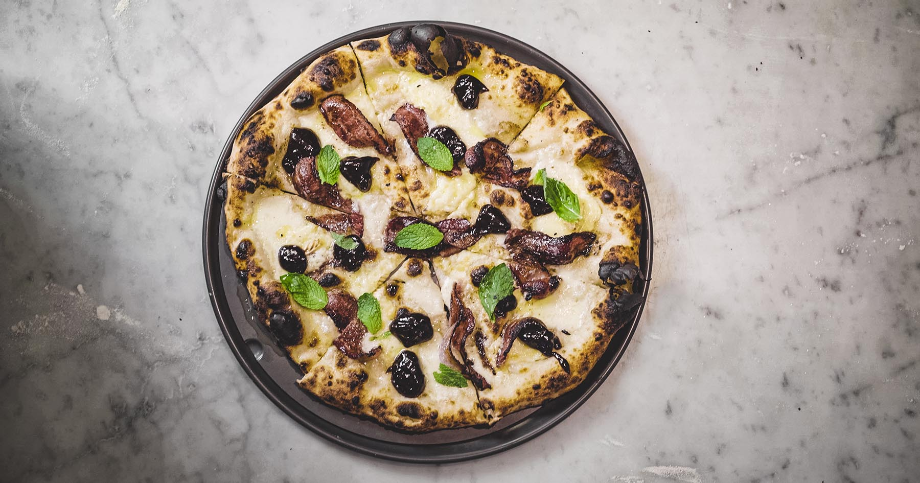 Pizza With Prune Jam Balsamic Glazed Bacon And Fresh Mint