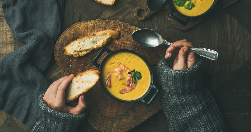 Woman eating soup and bread