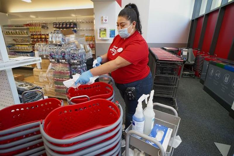 Target employee cleans shopping baskets