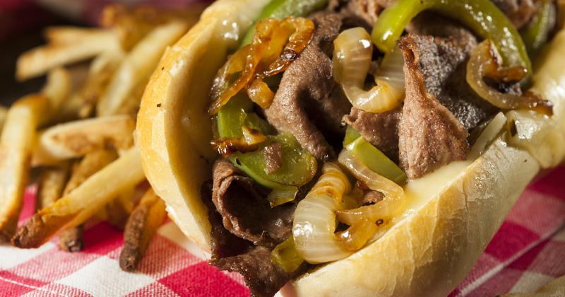 A cheesesteak with fries