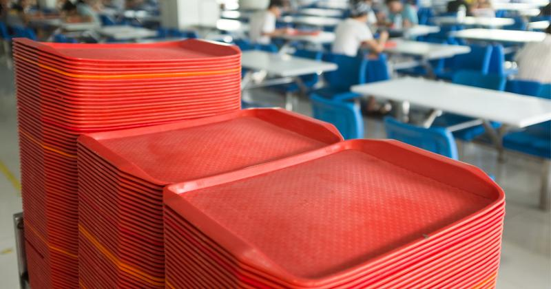 Red trays in cafeteria.