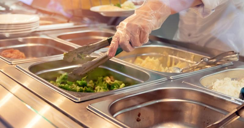 School nutrition professional serving food
