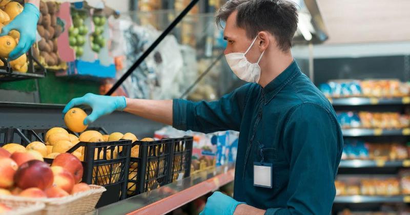 Grocery worker stocks lemons