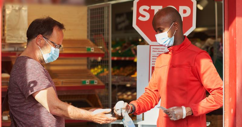 Grocery employee sanitizing