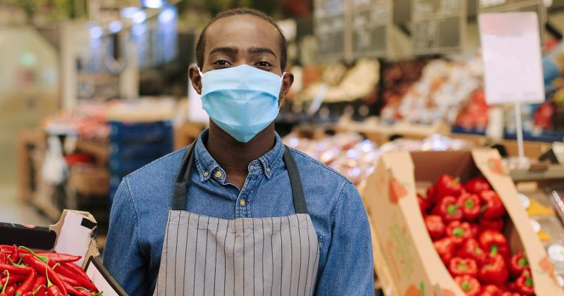 Grocery worker in mask