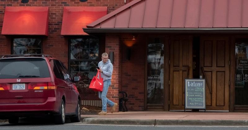 Delivery driver leaving restaurant