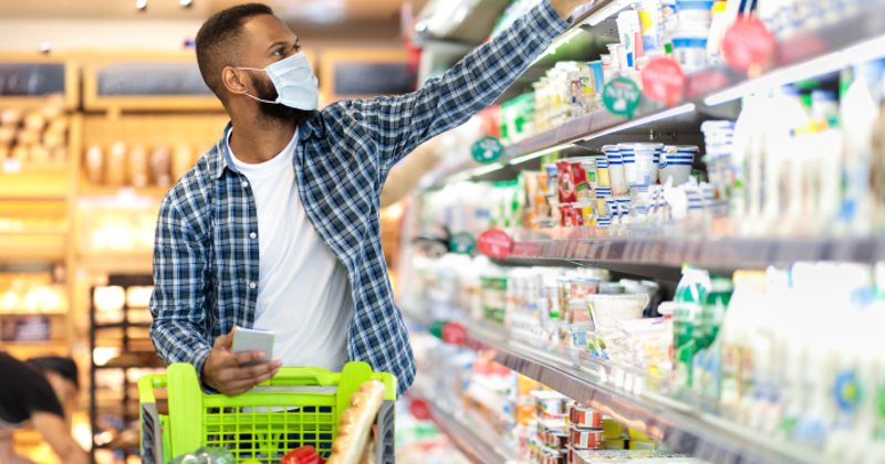 Grocery shopper placing items in cart