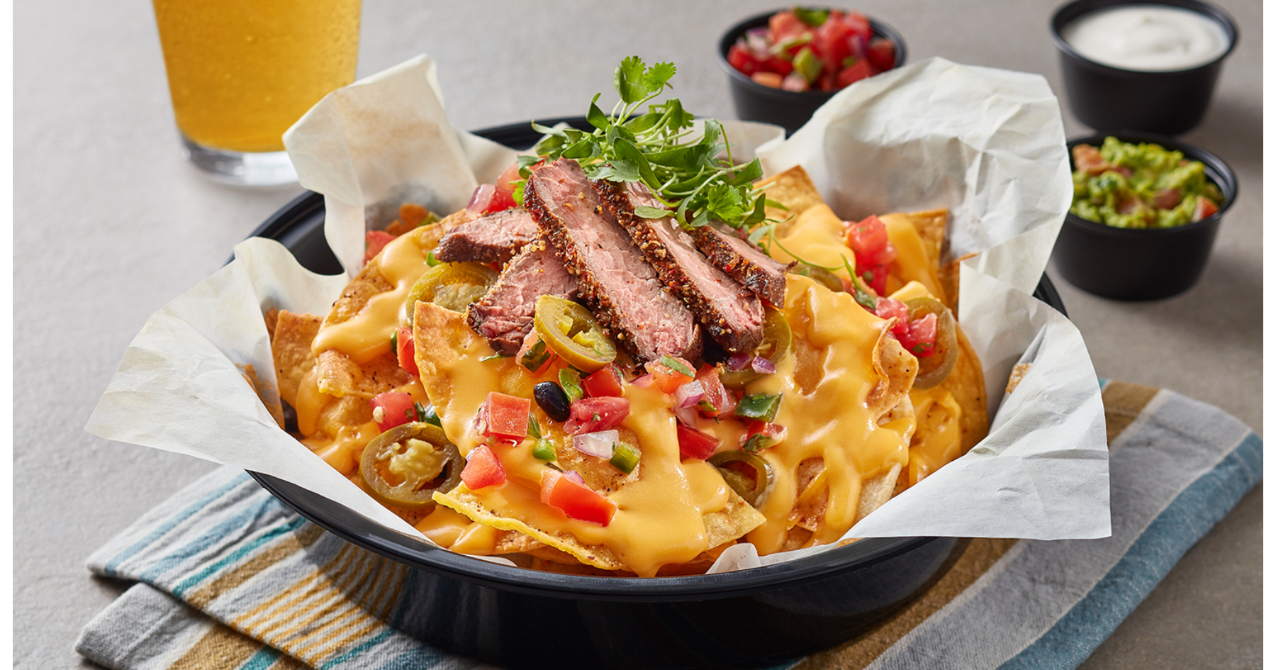 Nachos topped with cheese and steak