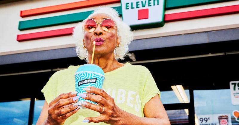 Woman with Slurpee outside 7-Eleven