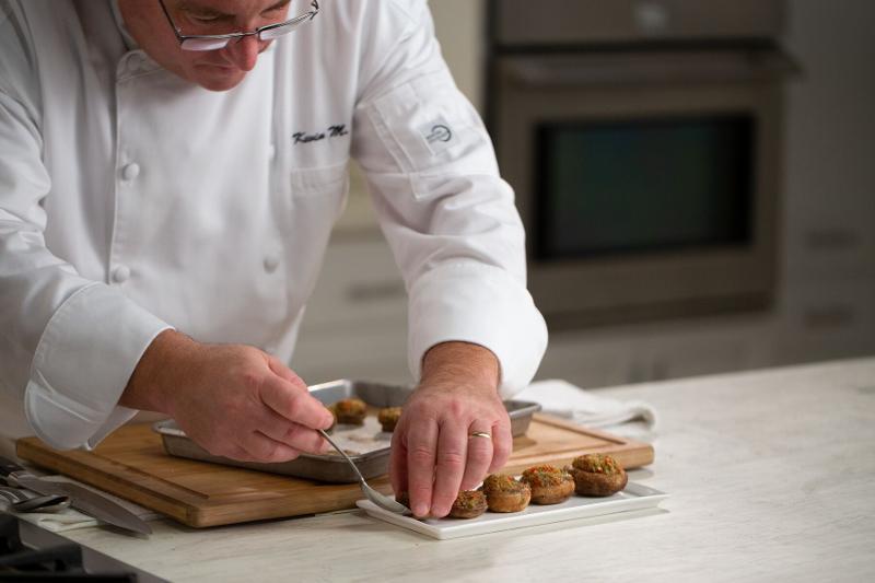 Instructor plating mushrooms