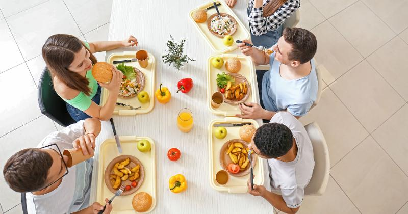 College students eating at table