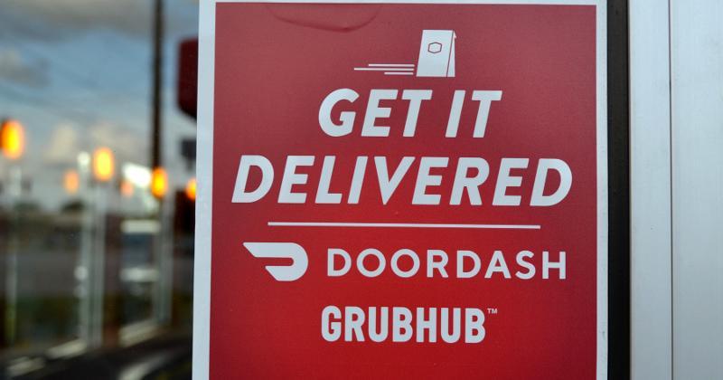 DoorDash and Grubhub logos on a sign