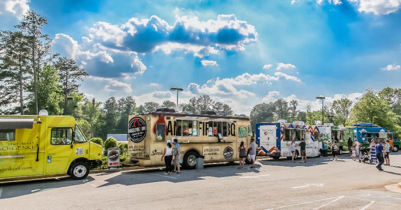 Food trucks lined up on the street.