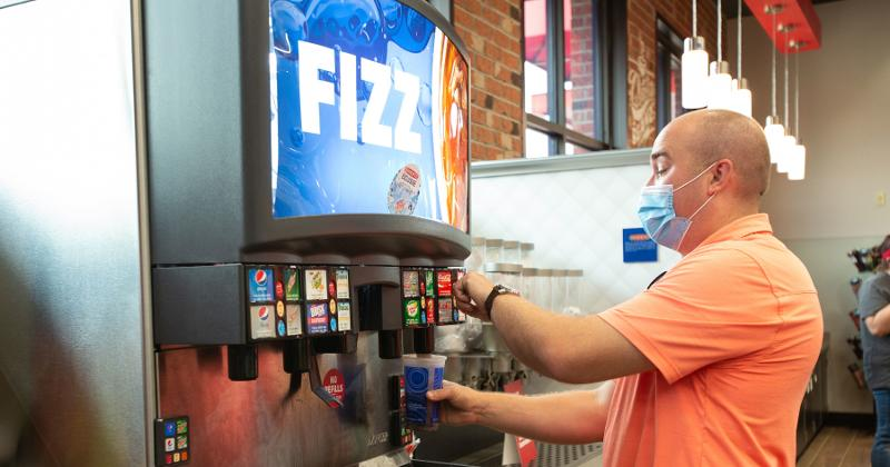 Sheetz customer getting a dispensed beverage