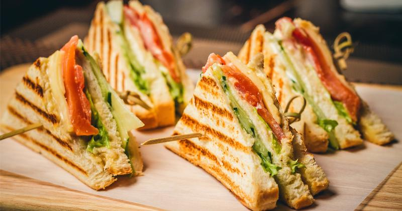 Sandwiches on a serving board.