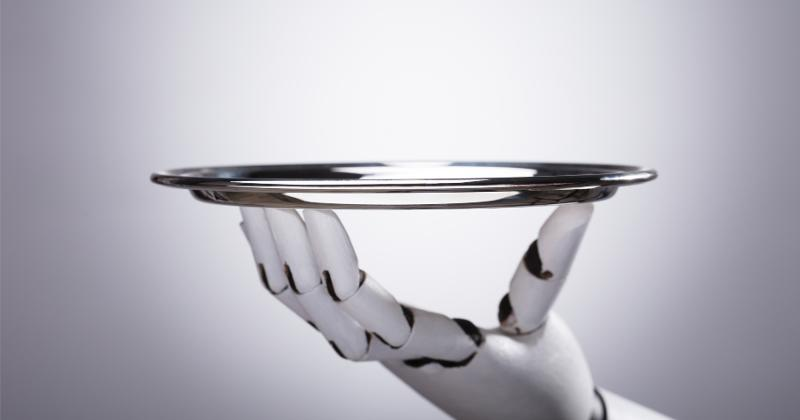 A robotic hand holding a plate.