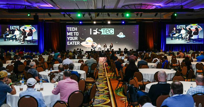 Attendees take in a panel at the FSTEC conference