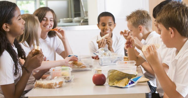 Students eat in the cafeteria.