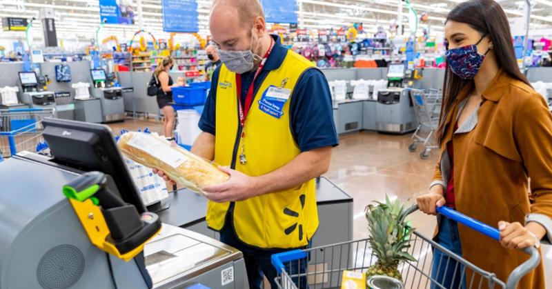 Walmart associate helping customer