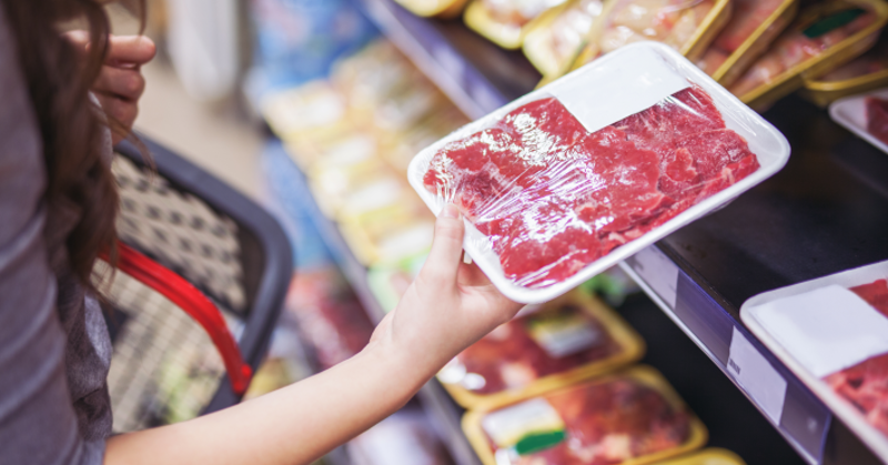 consumer holding packaged beef