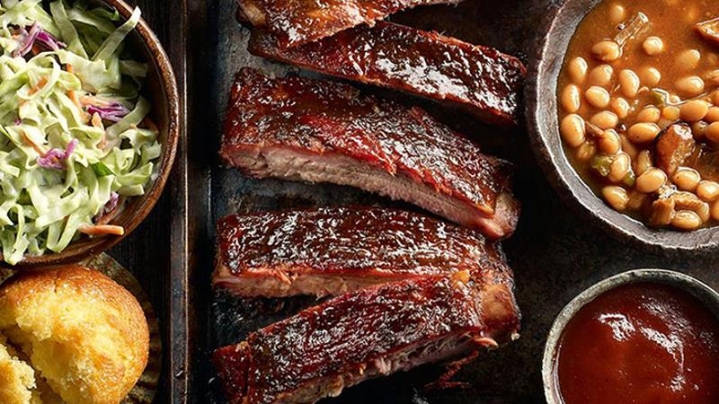 Famous Dave's ribs, beans, co-slaw, cornbread