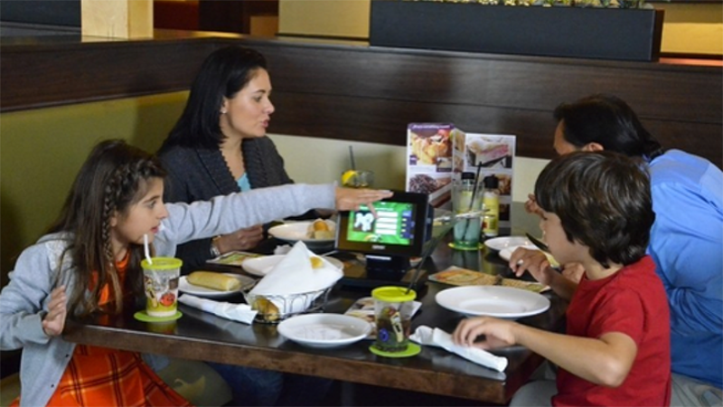 Family at Olive Garden digital menu