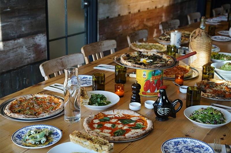 24 wood fired fare table spread
